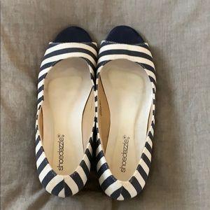 Blue and white striped peep toe shoe.